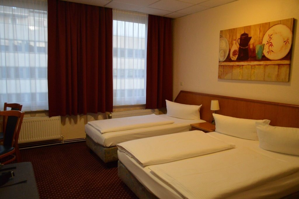ホテル ルーメン アム ハウプトバーンホフのベッドルーム